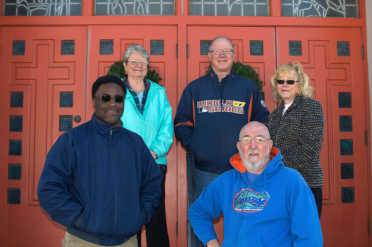 Marcus Dixon, left, director of the Multicultural Resource Center, works with church historians, Len McClenny, right, and, in back row from left, Joan McClenny, interim Pastor Jeff Brinkman and Kathy Kruger