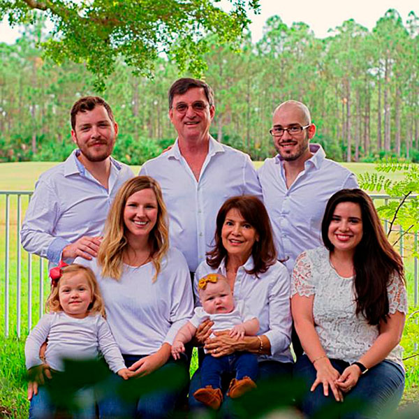 Ubilla, center, with his family: sons Donoso, back left, and Alonzo, back right, daughter-in-law Caitlin, left, wife, Liliam, center, and daughter, Mariana, right, along with granddaughters Matilda and Noa.
